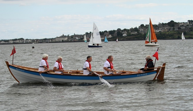 The Brochty on her maiden voyage, crewed by Mary Thomas, Sandy Bremner, Neil Ferguson, Gus Broahurst and John Knowles. Photo by Dougie Nicolson