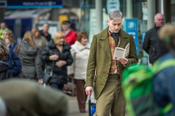 Sir Walter Scott (Fergus John McCann) reading the free Great Scott! book at Waverley Station c Chris Scott