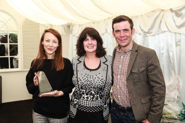 Sonnda (left) is presented with her award by Melanie Andrews and Johnathon Boyne