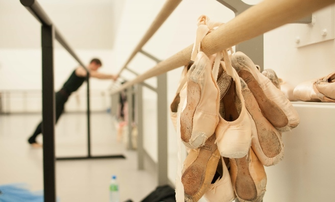 Ballet shoes take centre stage while Chris Harrison warms up at the barre. Photo by Upfront Photography