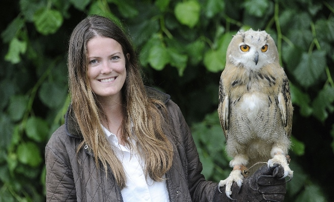 Rosie Drumm with a Siberian Eagle Owl chick at The Scottish Game Show