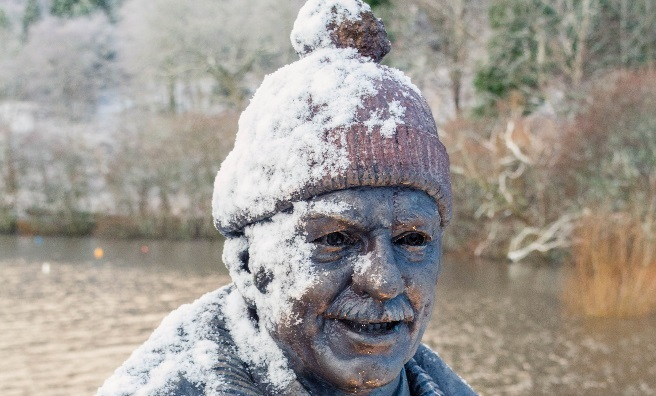 Snow's the perfect finishing touch to the Tom Weir statue on the banks of Loch Lomond. Photo by Paul Saunders Photography