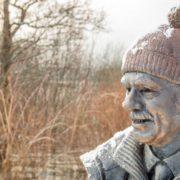 A snowy Tom Weir statue looks across Loch Lomond. Photo by Paul Saunders Photography