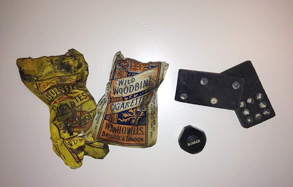 Found with the letter were dominoes, cigarette cards and an unusual golf game involving a dice.