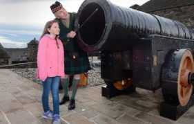 Major Niall Archibald inspects Mons Meg with helper Beth Graham. Neil Hanna.