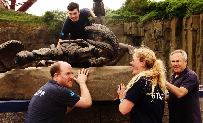Deep Sea World's aquarists get to grips with one of their new arrivals - a super-sized scorpion