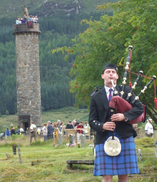 A piper at Glenfinnan Games beneath the Jacobite Monument