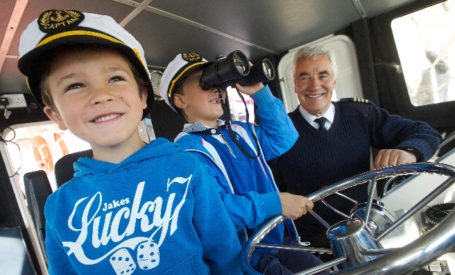 In the Wheelhouse! Laird Wharton (7) and Radleigh Wharton (5) with Seafari Managing Director, Colin Aston. Photo by Rob McDougall