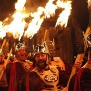 Blazing torches are carried to the top of Calton Hill in the Torchlight Procession. Photo by Lloyd Smith