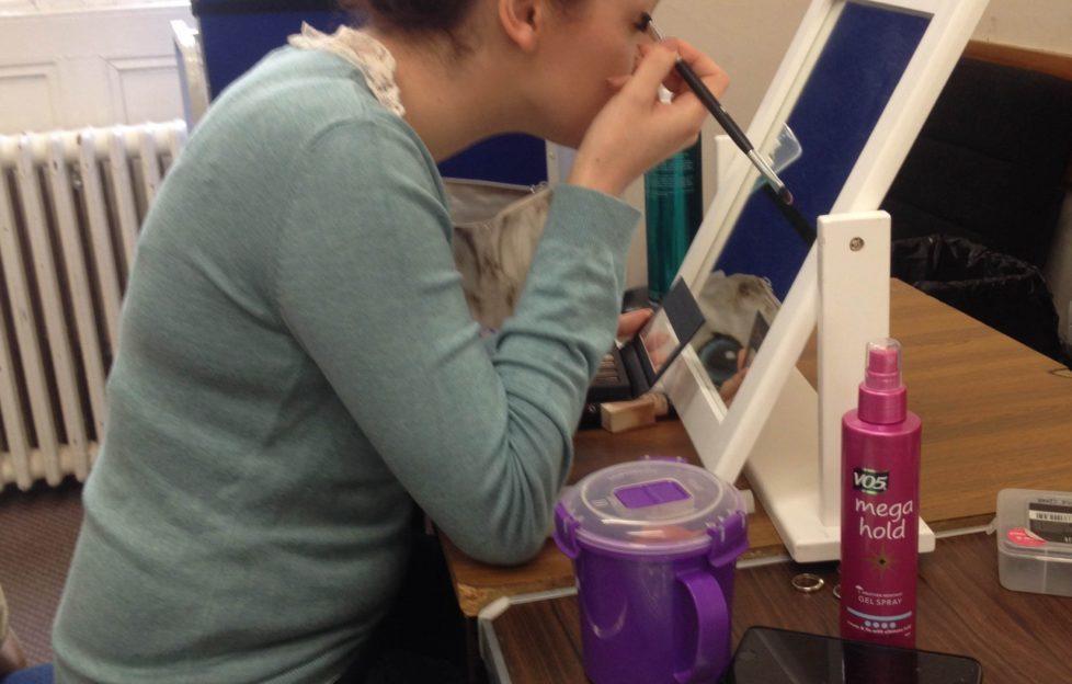 Jennifer France (Despina) doing her make-up pre-show
