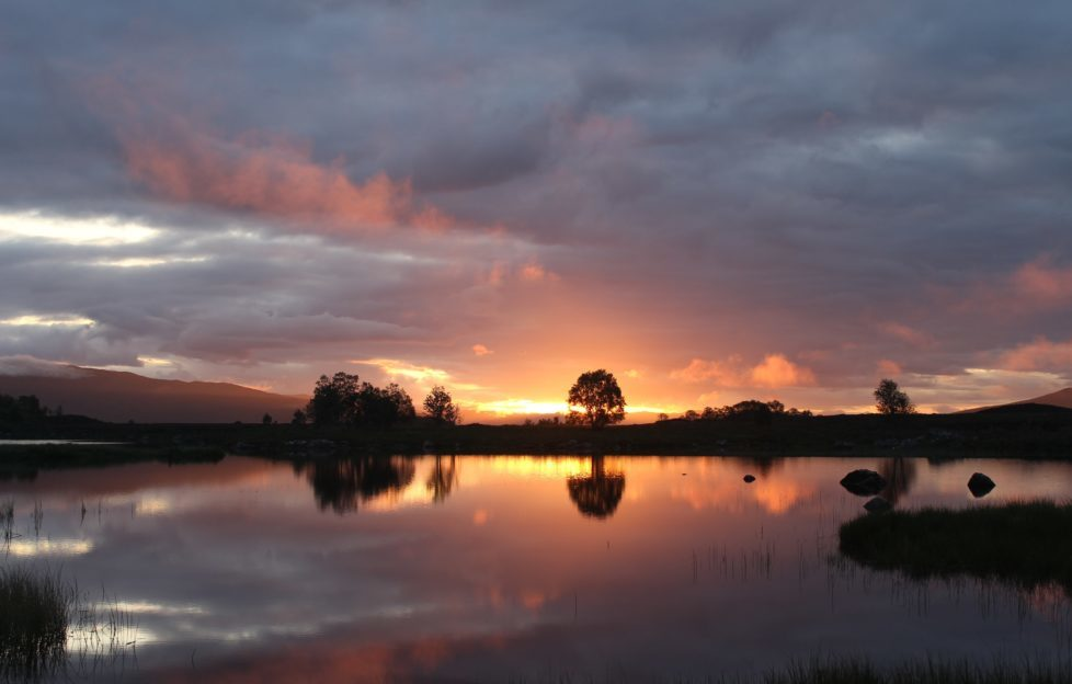 The sunrise over Loch Bà near Glen Coe