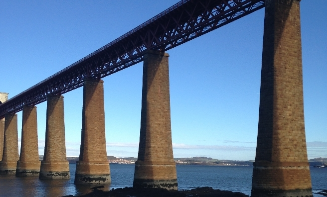 Early morning sunshine hits the Forth Rail Bridge at the start of our hike