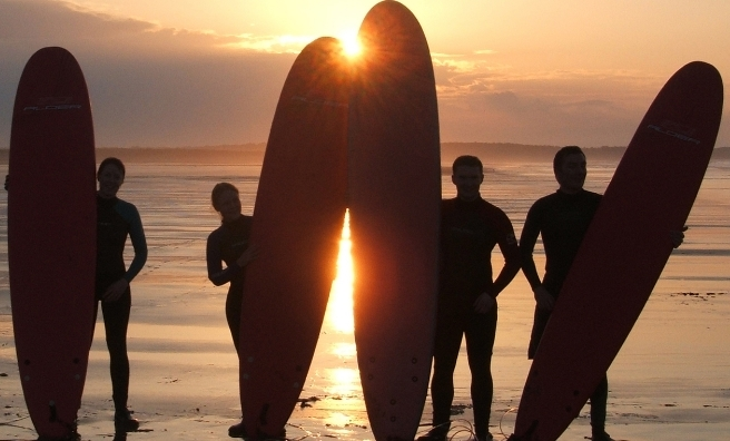 Sunset surfers in East Lothian, preparing for the surfing competition during the John Muir Outdoor Festival