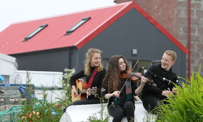 Oban High School students Emma Faird, Anna Garvin and Alastair MacLean at the official opening of the shelter. Pic by Tom Finnie