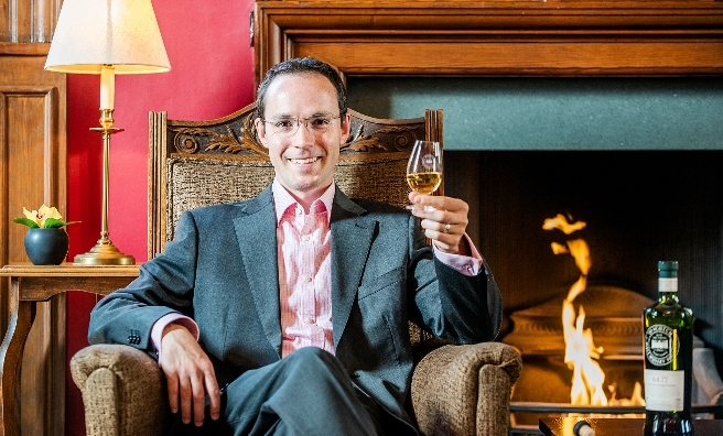 Slainte mhath! Dr Adam Moore relaxes with the whisky suggested by his personality.