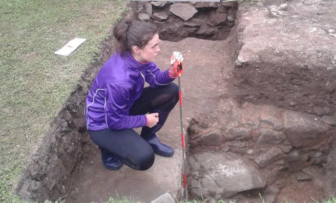One of the Trailblazer volunteers records the medieval walls uncovered during the excavation.