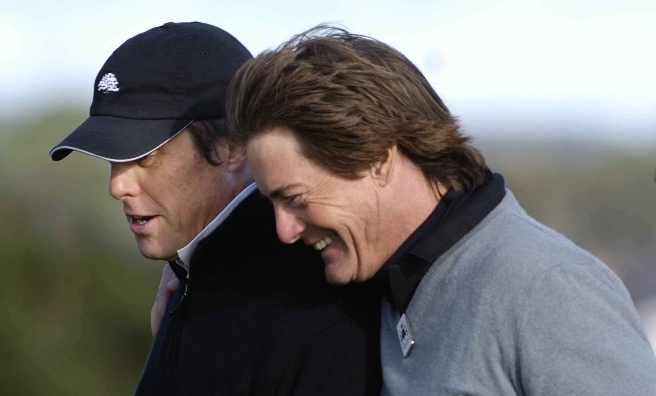 Hugh Grant and Kyle MacLachlan sharing a joke at a previous Dunhill. Photo by Sandy Young
