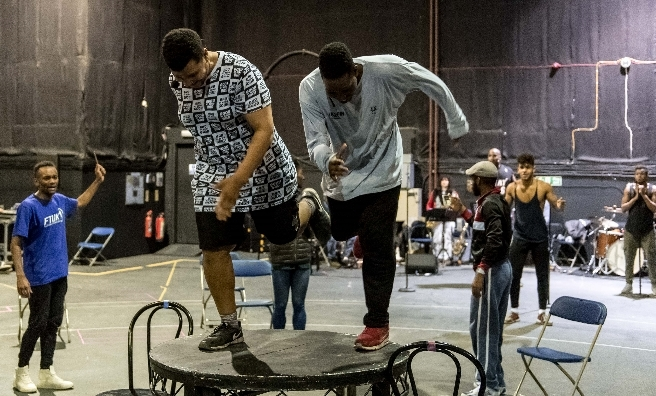 Dancing on the tables at rehearsals for Five Guys Named Moe. Photo by Manual Harlan