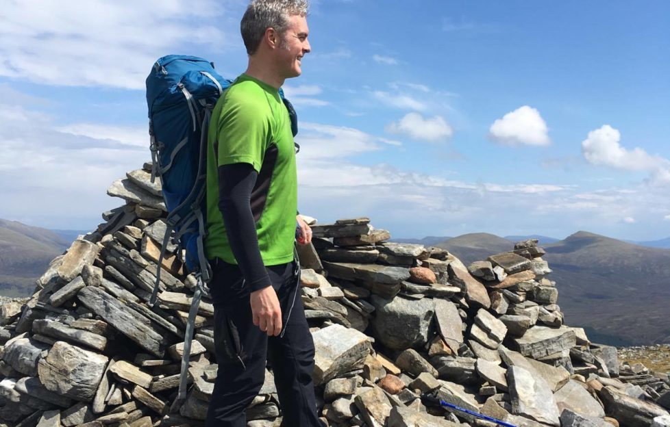 The sun came out for a picture or two by the summit cairn. Pic: Stuart Wallis