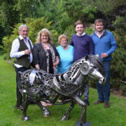 Steve's family at the unveiling. His parents (left) have lost their garage, which is now Steve's workshop!