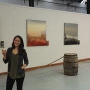 Eva Ullrich with the exhibition of her paintings in Tomatin Distillery