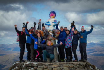 Pics of artist Douglas Samson, carrying up a statue of Oor Wullie to the top of Ben Nevis with a group of friends and volunteers to help him. for Oor Wullie Bucket Trail.